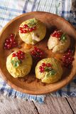Baked apples with honey, mint and red currant closeup vertical t Stock Photo