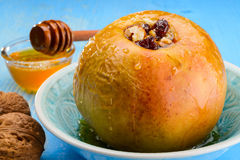 Baked apples with nuts and honey Stock Photography