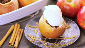 Baked apples. Organic baked apples served with vanilla ice cream stock video footage