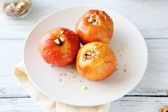Baked apples on a plate Royalty Free Stock Photos
