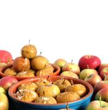 Baked apples in round clay bowls and lot of ripe fresh apples isolated on white royalty free stock photo