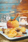 Baked apples in rustic setting served for Christmas Royalty Free Stock Photos