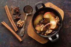 Baked apples with spices. Baked apples with winter spices, walnut and honey, top view Stock Photos