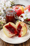 Baked apples stuffed with blueberry jam Royalty Free Stock Photo