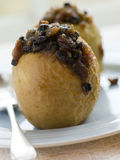 Baked Apples stuffed with Christmas Pudding Stock Photography