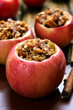 Baked apples stuffed with granola Stock Photos