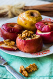 Baked apples with walnuts, honey and cinnamon, dessert Stock Photos