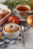 Baked apples on white plate with cup of tea Royalty Free Stock Images