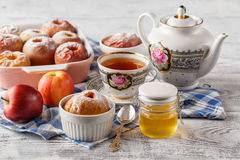 Baked apples on white plate with cup of tea Stock Photo