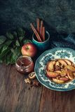 Baked apples with spices. Baked apples with winter spices, walnut and honey, top view Stock Images