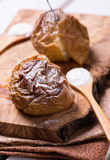Baked apples on wooden board Stock Photography