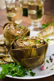 Baked artichokes cooked with garlic sauce Royalty Free Stock Photo