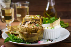 Baked artichokes cooked with garlic sauce Stock Photos