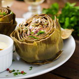 Baked artichokes cooked with garlic sauce Stock Images