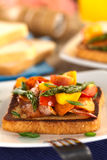 Baked asparagus, mango, tomato, carrot and bacon sandwich Royalty Free Stock Image
