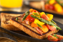 Baked asparagus, mango, tomato, carrot and bacon sandwich Royalty Free Stock Images