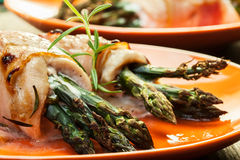 Baked asparagus wrapped in chicken and bacon Stock Photography