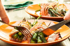 Baked asparagus wrapped in chicken and bacon Royalty Free Stock Photography