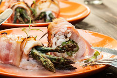 Baked asparagus wrapped in chicken and bacon Stock Photo