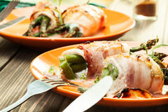 Baked asparagus wrapped in chicken and bacon Royalty Free Stock Photos
