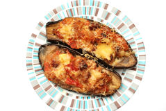 Baked aubergine. Stuffed with vegetables and cheese Stock Photography