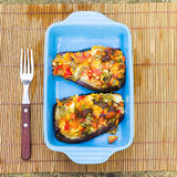 Baked aubergines with vegetables and cheese Stock Image