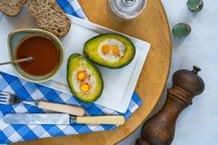 Baked avocado with quail eggs Royalty Free Stock Photo