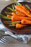Baked baby carrots with tails Stock Photography