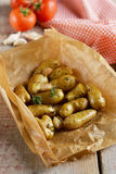 Baked baby potatoes with garlic and herbs Stock Photo