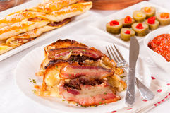 Baked bacon and melting cheese Stock Image