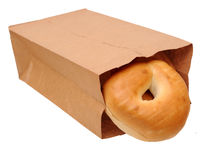 Baked bagels in paper bag Stock Images