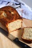 Baked banana bread knife board Royalty Free Stock Images