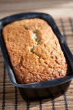 Baked banana bread on wooden table stock photography