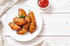 Barbecue chicken wings with white sesame. Baked barbecue chicken wings with white sesame stock photos