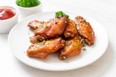 Barbecue chicken wings with white sesame. Baked barbecue chicken wings with white sesame royalty free stock photos