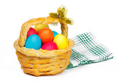 Baked basket with Easter colored eggs Royalty Free Stock Photography