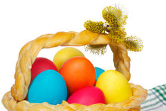 Baked basket with Easter colored eggs Stock Photo