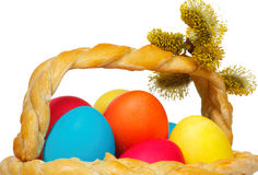Baked basket with Easter colored eggs Stock Images