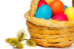 Baked basket with Easter colored eggs Stock Photography