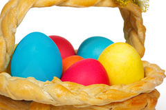 Baked basket with Easter eggs. Baked basket with Easter colored eggs Stock Images