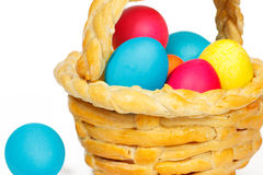 Baked basket with Easter eggs. Baked basket with Easter colored eggs Royalty Free Stock Photos