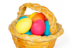 Baked basket with Easter eggs. Baked basket with Easter colored eggs Royalty Free Stock Image