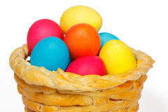 Baked basket with Easter eggs. Baked basket with Easter colored eggs Stock Photos