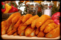 Baked battered spicy seasoned potato wedges Stock Images