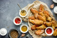 Baked bbq chicken wings with crispy skin. Top view royalty free stock photo