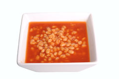 Baked Beans. In a square bowl, shot in studio and isolated,image is a cut out and has clipping lines Stock Photography