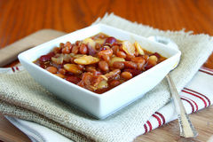 Baked Beans. White bowl filled with baked beans Royalty Free Stock Photos