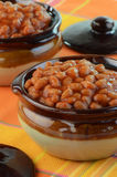 Baked beans. In individual ceramic bowls, vertical format Royalty Free Stock Photography