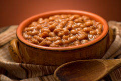 Baked Beans. A bowl of delicious baked beans with molasses Stock Photos