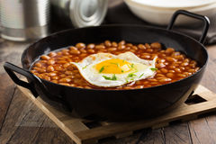 Baked Beans with fried egg Royalty Free Stock Photo